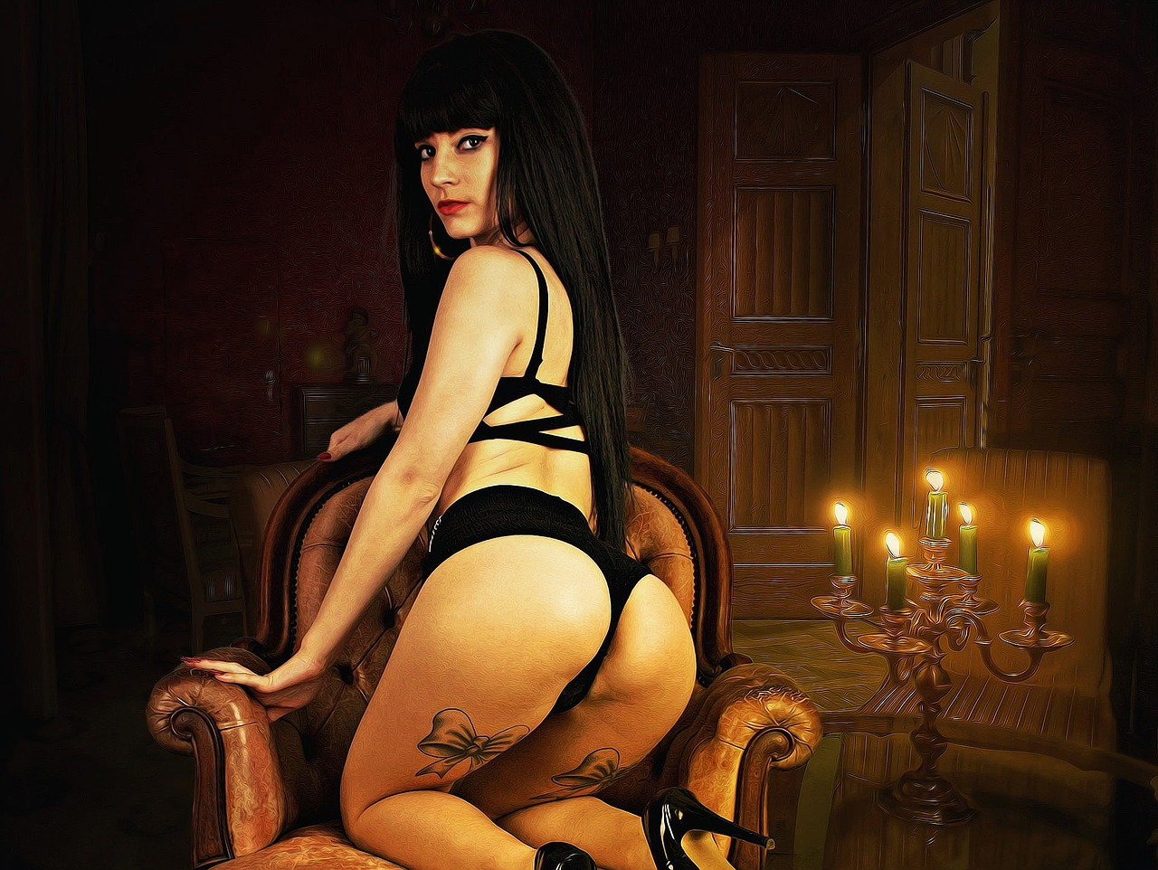 Женщина в сексуальной позе на кресле